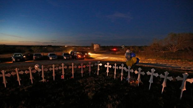 Twenty-six crosses stand on a field representing the victims of the shooting in Sutherland Springs, Texas. Photograph: Larry Smith/EPA