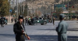 Afghan security officials take positions near the scene of an attack by armed men on Shamshad TV station in Kabul, Afghanistan. Photograph: Jawad Jalali/EPA