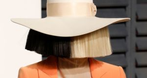 Sia is known for valuing her privacy and often covers her face with wigs, masks andpaper bags.  Photograph:  Getty Images