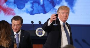 US president Donald Trump and South Korean president Moon Jae-in toast at the start of a dinner at the Blue House in Seoul on Tuesday. Photograph: Andrew Harnik/AP