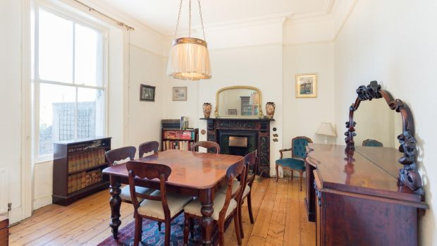 10 Castlepark Road, Sandycove, Co Dublin: The diningroom features a brown marble fireplace and a large sash window