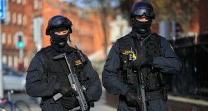 Members of the Garda Armed Support Unit on Bride Street in  Dublin on Tuesday. Photograph:   Collins
