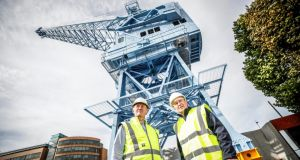 Crane 292: Dublin Port chief executive Eamonn O'Reilly with former crane operator Liam O'Brien at the restored machine. Photograph: McCabe Photography