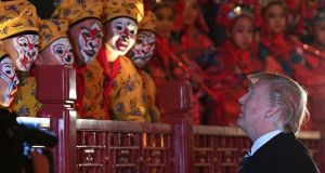 US president Donald Trump talks to opera performers at the Forbidden City in Beijing on Wednesdsay, the first day of his visit to China. Photograph:  Jim Watson/AFP/Getty Images