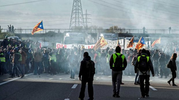 Protesters block the AP-7 road in Figueres on Wednesday, as part of a strike called in Catalonia to protest against the imprisonment of pro-independence leaders. Photograph: Robin Townsend/EPA