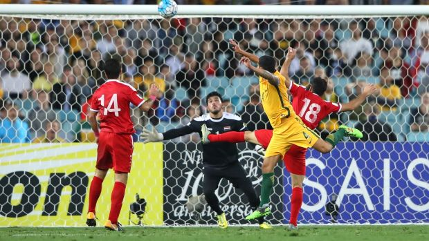 Tim Cahill scores during Australia's Asian playoff win over Syria. Photograph: Cameron Spencer/Getty