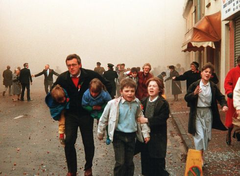 Survivors leave the scene on 8th November 1987 during a Remembrance Sunday ceremony in Enniskillen. Today 8th November marks the 30th anniversary of the IRA murder of 12 people during the event. Photograph: Pacemaker