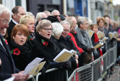 Crowds line the streets during the unveiling of a new memorial to the 12 victims of the IRA's 1987 Remembrance Sunday bomb attack in Enniskillen on Wednesday 8th November. Photograph: Niall Carson / PA