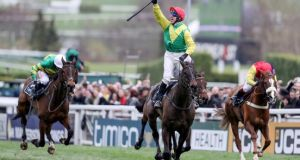 Robbie Power celebrates Sizing John's victory in the 2017 Cheltenham Gold Cup. Photograph: Dan Sheridan/Inpho