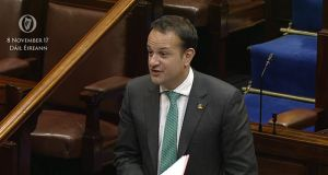 Taoiseach Leo Varadkar wearing a shamrock poppy badge while speaking at the Dáil.