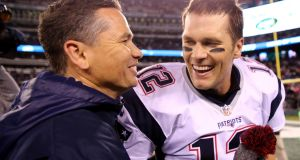 Tom Brady  of the New England Patriots and trainer Alex Guerrero.  Guerrero became godfather to one of Brady's children, and is regarded as a member of his and his wife's  extended family. Photograph:   Getty Images