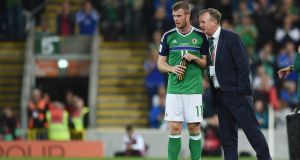 Michael O'Neill speaks to Chris Brunt during Northern Ireland's World Cup qualifier against Czech Republic. Photo: Getty Images