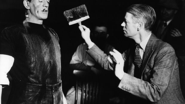 Boris Karloff with cigarette is dirtied by director James Whale in between scenes from the film 'Frankenstein', 1931. Photograph: Universal/Getty Images