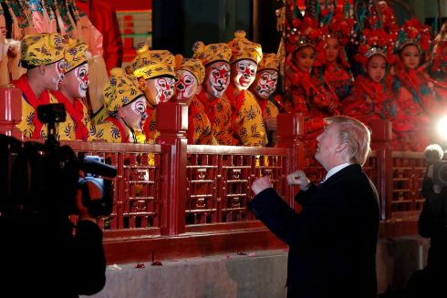 TRUMP ON TOUR: US president Donald Trump meets opera performers at the Forbidden City in Beijing, China, while on his tour of the far east. Photograph: Jonathan Ernst/Reuters