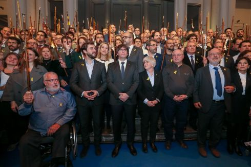 MAYORAL SUPPORT: Ousted Catalan leader Carles Puigdemont (centre) and a group of Catalan mayors in Brussels during a conference of the mayors in support of the ousted government of Catalonia.  Photograph: Stephanie Lecocq/EPA
