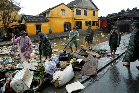 DAMREY'S DAMAGE: Vietnamese soldiers clean up debris caused by flooding during Typhoon Damrey in the ancient Unesco heritage town of Hoi An. Photograph: Jorge Silva/Reuters