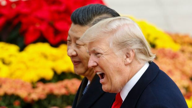 US president Donald Trump takes part in a welcoming ceremony with China's president Xi Jinping in Beijing during a 10-day trip to Asia. Photograph: Thomas Peter-Pool/Getty Images.