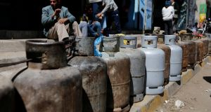 Cooking gas cylinders are lined up outside a gas station  in Sanaa, Yemen where food and fuel are in short supply. Photograph: Khaled Abdullah/Reuters.