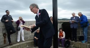 You know wjhen? Bryan Murray reading Ulysses at Joyce's Tower in Sandycove during the Bloomsday celebrations. But what date? Photograph: Cyril Byrne