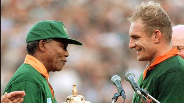 South Africa's president Nelson Mandela hands Francois Pienaar the Webb Ellis Trophy after the Springboks' World Cup final win over New Zealand in 1995. Photograph: Jean-Pierre Muller/Getty