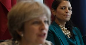 Priti Patel, who  resigned as international development secretary,  watches British prime minister Theresa May at a meeting earlier this year. File photograph: Stefan Rousseau/PA Wire