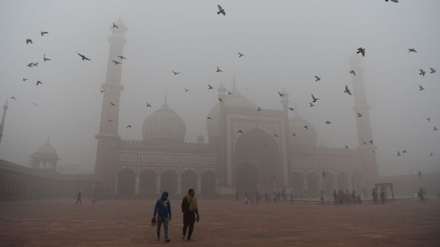 Visitors walk through the courtyard of Jama Masjid amid heavy smog in the old quarters of New Delhi on November 8th, 2017. Photograph: Sajjad Hussain/AFP/Getty Images
