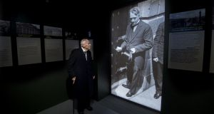 The late former Taoiseach Liam Cosgrave (96) standing in front of a photograph of his father WT Cosgrave at the GPO Witness History Visitor Centre during its official opening. Photograph: Brenda Fitzsimons