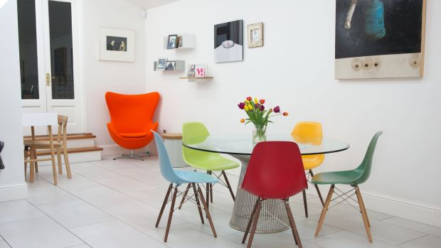 Carol Anne replaced her long dining table with a more space-friendly round table and colourful chairs