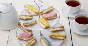 Les Carolines: miniature-style eclairs filled with pastry cream are adorable served with afternoon tea. Photograph: Harry Weir