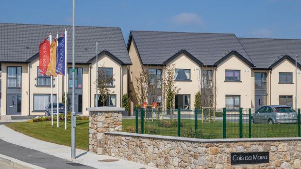 A three-bed, three-bath, semi-detached house in the Cois na Mara development is on the market for €257,000