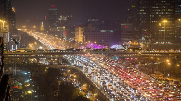 Beijing gridlock: with six million cars clogging the streets, the Chinese capital's traffic snarl-ups leave little scope for big egos in fancy SUVs pulling up for soccer training. Photograph: Xiao Lu Chu/Getty