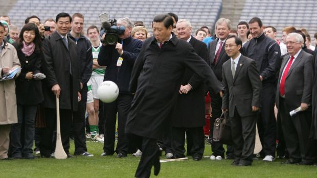 Viral photograph: sports fan Xi Jinping, who is now his country's president, kicking a football at Croke Park in 2012. Photograph: Alan Betson