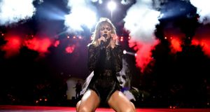 Kneel diamond: Taylor Swift in concert. Photograph: John Shearer/Getty Images