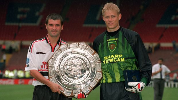 Keane and Schmeichel pose with the Charity Shield in 1997