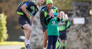 Robbie Henshaw and Bundee Aki have their picture taken with Jennifer Malone at the Ireland rugby squad training at Carton House, Co Kildare. Photograph: Morgan Treacy/Inpho