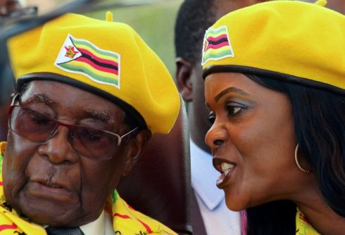 President Robert Mugabe listens to his wife Grace Mugabe at a rally of his ruling ZANU-PF party in Harare, Zimbabwe, November 8, 2017. Photograph: Philimon Bulawayo/Reuters