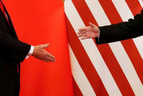 US president Donald Trump and China's President Xi Jinping about to shakes hands. Photograph: Damir Sagolj