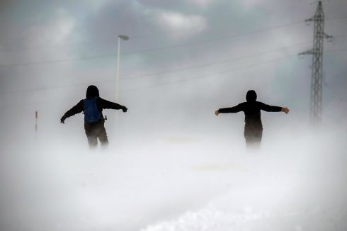 A couple in a blizzard in Branavieja, Cantabria, northern Spain. Photograph: Pedro Puente