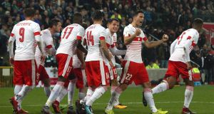 Switzerland players celebrate after Ricardo Rodriguez  scored from the penalty spot during the World Cup playoff first leg at Windsor Park in Belfast. Photograph:  Niall Carson/PA Wire