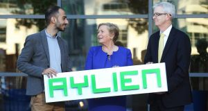 Aylien chief executive Parsa Ghaffari with Tánaiste Frances Fitzgerald and Joe Healy of  Enterprise Ireland. Photograph: Finbarr O'Rourke