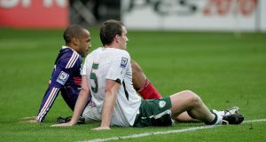 Theirry Henry and Richard Dunne after the infamous Paris encounter in 2009. Photograph: Inpho