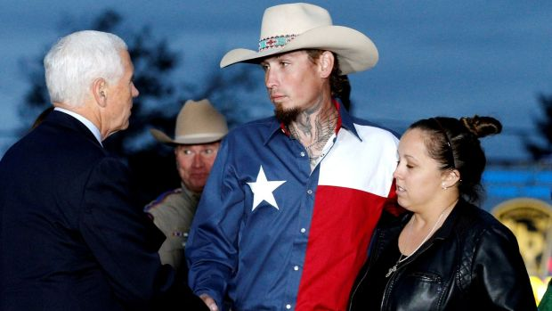 US vice president Mike Pence shakes hands with Johnnie Langendorff, who chased the assailant, near the site of the shooting at the First Baptist Church of Sutherland Springs in Texas. Photograph: Reuters/Jonathan Bachman