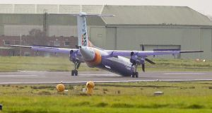 A Flybe aircraft makes an emergency landing at Belfast International Airport due to an issue with its nose gear. Photograph: Photograph: Alan Lewis/Photopress