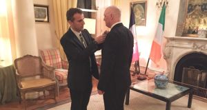 The French ambassador Stéphane Crouzat bestowing an honour on Seán Mac Cárthaigh