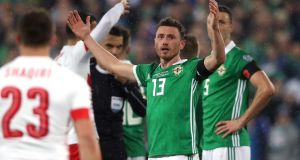 Corry Evans was harshly judged to have handled the ball in the area, resulting in Switzerland's match-winning penalty against Ireland. Photograph: Niall Carson/PA