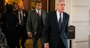 Robert Mueller, the former FBI director and special counsel leading the Russia investigation: the inquiry continues while Donald Trump is overseas. Photograph: Doug Mills/New York Times
