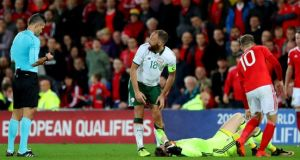 David Meyler is booked for a challenge on Wayne Hennessey at the end of Ireland's win over Wales - ruling him out of the playoffs. Photograph: James Crombie/Inpho