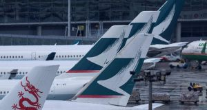 Cathay Pacific  passenger planes at Hong Kong's international airport: deletion from index is latest blow for the airline, which was founded in 1946. Photograph: Anthony WallacE/AFP/Getty Images