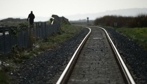 A walker along the Kilcoole beach, Co Wicklow, as Irish Rail strike was held nationwide. Photograph: Cyril Byrne