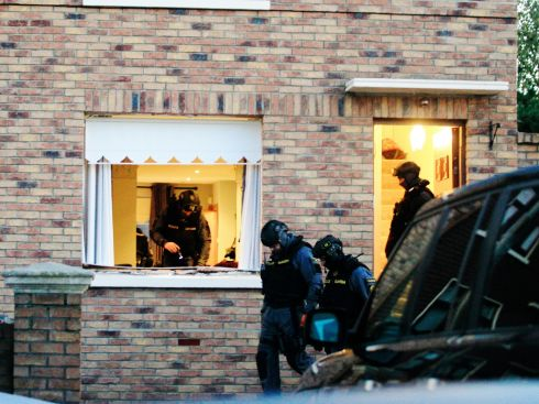 An Emergency Response Unit gains forced entry through a window to a house on Ratoath Road, Cabra. Photograph: Padraig O'Reilly